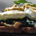Oat Cake with creamy spinach goat cheese and olives and almonds pate tapa
